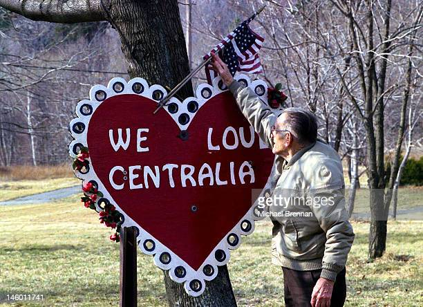 Lamar Mervine the Mayor of Centralia Pennsylvania adjusts a 'We Love Centralia' sign 13th March 2000 The town situated in the deep mining area of...