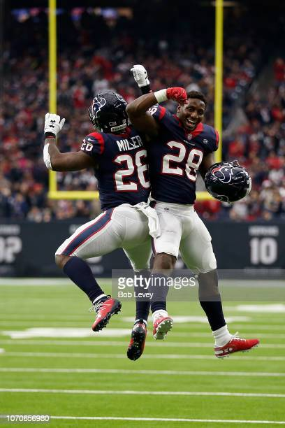 Lamar Miller and Alfred Blue of the Houston Texans celebrate a rushing touchdown against the Indianapolis Colts in the third quarter at NRG Stadium...
