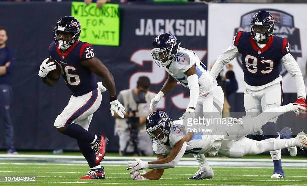 Lamar Miller of the Houston Texans breaks the tackle attempt of Kevin Byard of the Tennessee Titans for a 97 yard touchdown at NRG Stadium on...