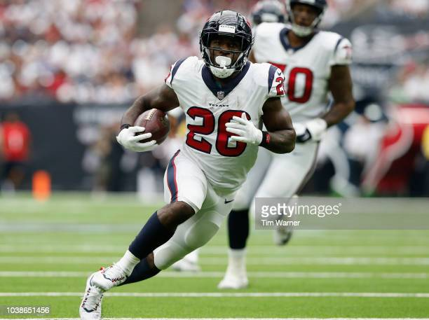Lamar Miller of the Houston Texans carries the ball in the first half against the New York Giants at NRG Stadium on September 23, 2018 in Houston,...