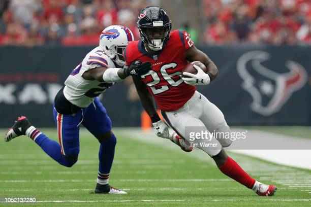 Lamar Miller of the Houston Texans carries the ball in the first half defended by Tre'Davious White of the Buffalo Bills at NRG Stadium on October...