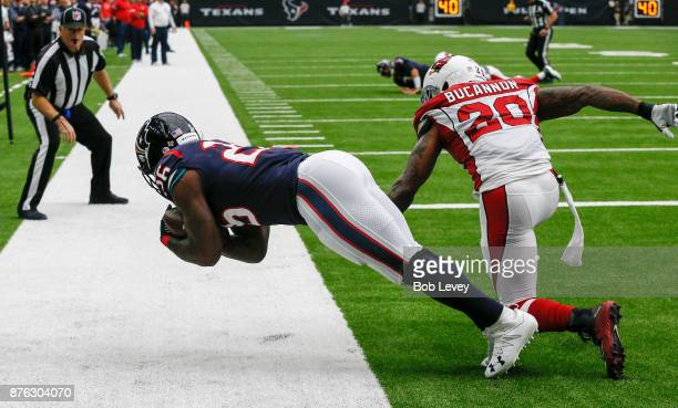 Lamar Miller of the Houston Texans catches a pass for a touchdown in the second quarter as Deone Bucannon of the Arizona Cardinals defends at NRG...