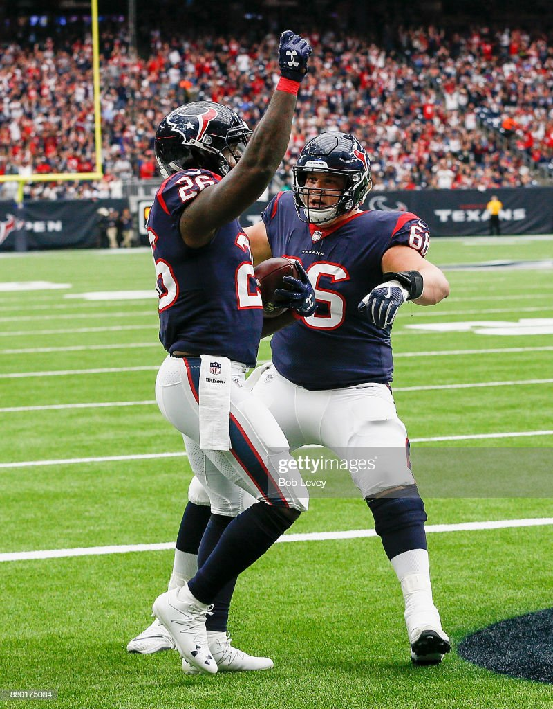 Lamar Miller #26 of the Houston Texans celebrates a touchdown with Nick Martin #66 against the Arizona Cardinals at NRG Stadium on November 19, 2017 in Houston, Texas.
