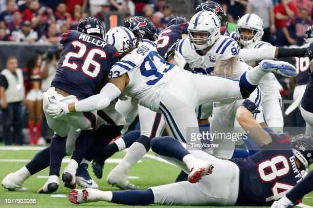 Lamar Miller of the Houston Texans is stopped for a loss by Jabaal Sheard of the Indianapolis Colts in the second quarter during the Wild Card Round...