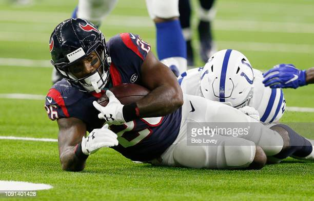 Lamar Miller of the Houston Texans is tackled by Clayton Geathers of the Indianapolis Colts during the Wild Card Round at NRG Stadium on January 05,...