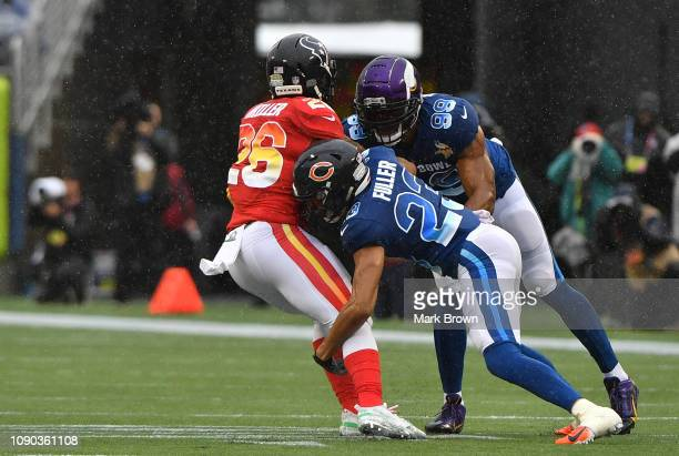 Lamar Miller of the Houston Texans is tackled by Kyle Fuller of the Chicago Bears and Danielle Hunter of the Minnesota Vikings in the first quarter...