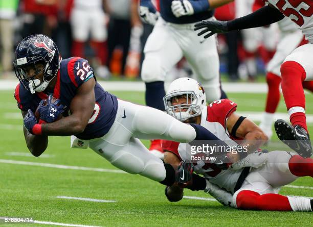Lamar Miller of the Houston Texans is tackled by Tyrann Mathieu of the Arizona Cardinals at NRG Stadium on November 19 2017 in Houston Texas