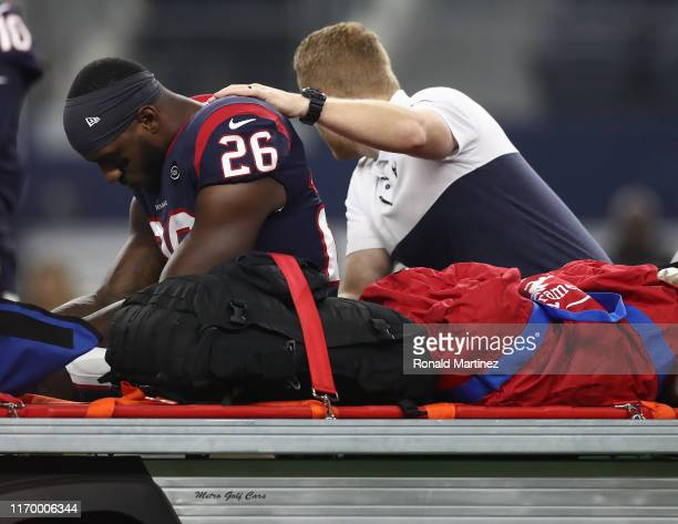 Lamar Miller of the Houston Texans leaves the game after an injury in the first quarter during a NFL preseason game against the Dallas Cowboys at...