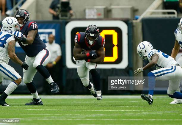 Lamar Miller of the Houston Texans runs the ball defended by Nate Hairston of the Indianapolis Colts in the second quarter at NRG Stadium on November...