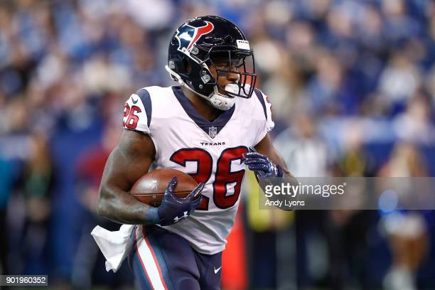 Lamar Miller of the Houston Texans runs with the ball against the Indianapolis Colts during the first half at Lucas Oil Stadium on December 31, 2017...