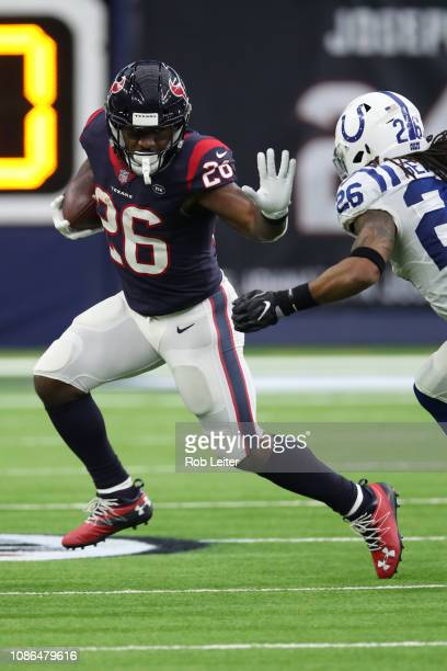 Lamar Miller of the Houston Texans runs with the ball during the game against the Indianapolis Colts at NRG Stadium on December 9, 2018 in Houston,...