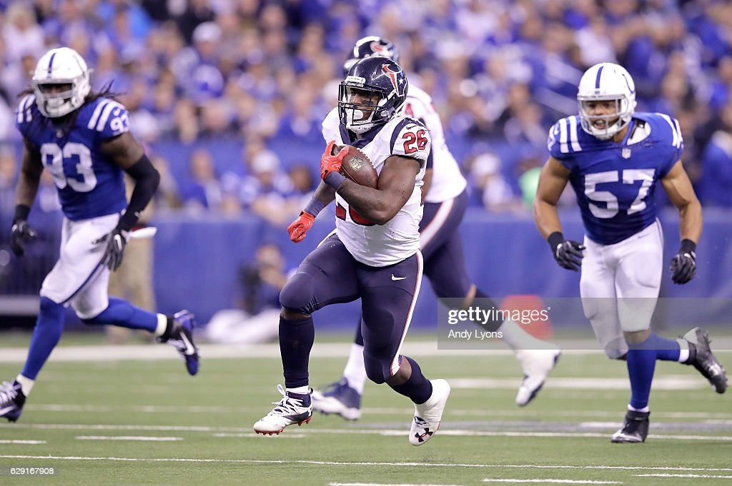 Lamar Miller #26 of the Houston Texans runs with the ball during the game against the Indianapolis Colts at Lucas Oil Stadium on December 11, 2016 in Indianapolis, Indiana.