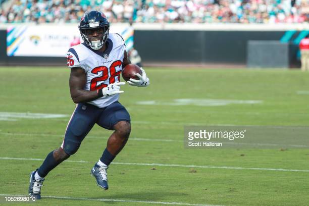 Lamar Miller of the Houston Texans runs with the ball during the first half against the Jacksonville Jaguars at TIAA Bank Field on October 21, 2018...