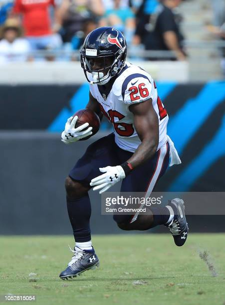 Lamar Miller of the Houston Texans rushes for yardage during the game against the Jacksonville Jaguars at TIAA Bank Field on October 21 2018 in...