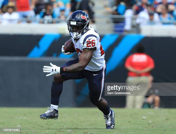 Lamar Miller of the Houston Texans rushes for yardage during the game against the Jacksonville Jaguars at TIAA Bank Field on October 21, 2018 in...