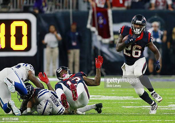 Lamar Miller of the Houston Texans rushes up the middle as he receives a block from Braxton Miller against the Indianapolis Colts at NRG Stadium on...