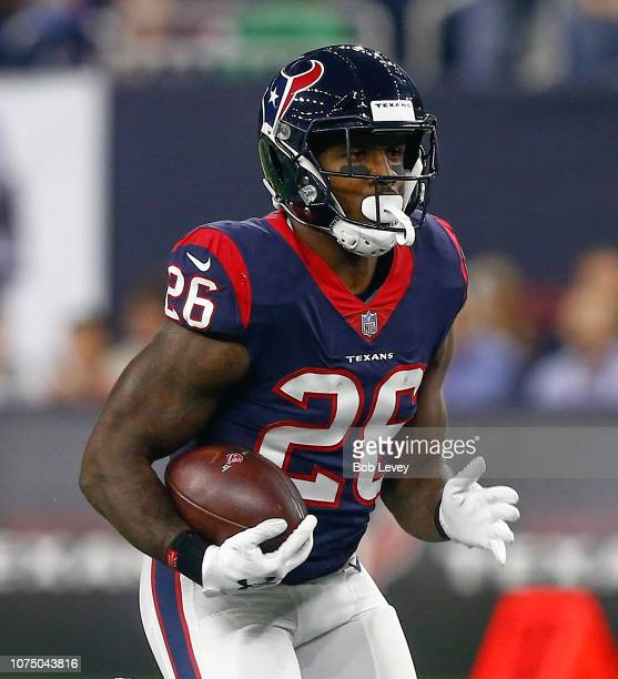 Lamar Miller of the Houston Texans rushes with the ball against the Tennessee Titans at NRG Stadium on November 26, 2018 in Houston, Texas.