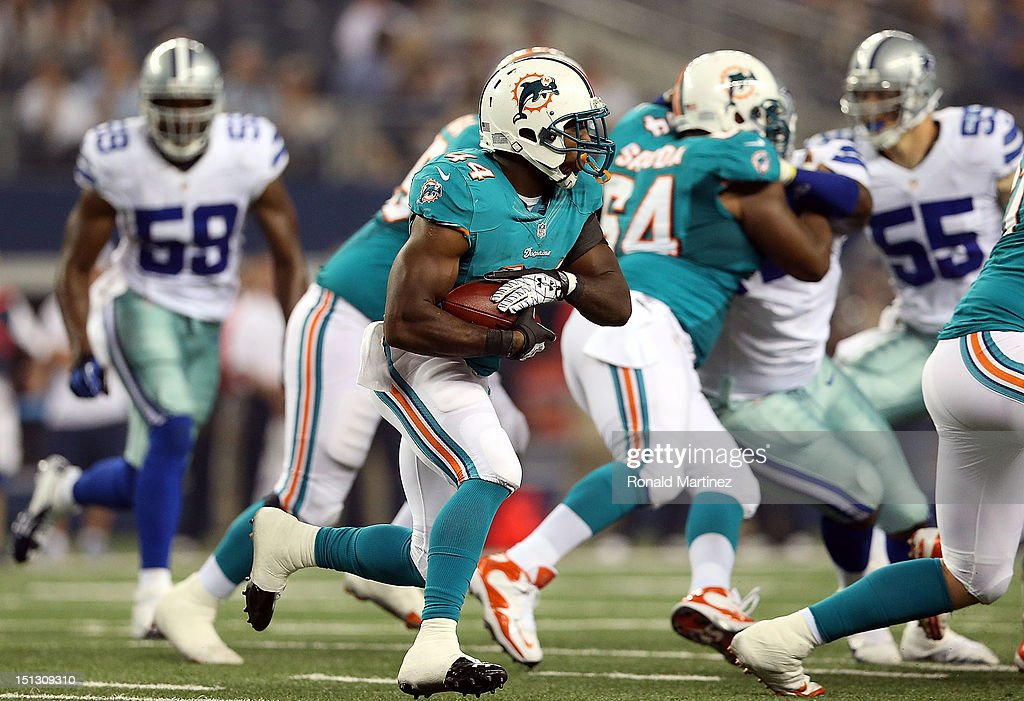 Lamar Miller #44 of the Miami Dolphins at Cowboys Stadium on August 29, 2012 in Arlington, Texas.