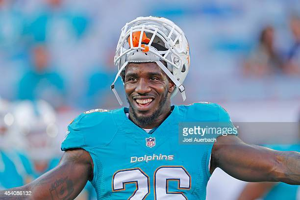 Lamar Miller of the Miami Dolphins warms up prior to the preseason game against the Dallas Cowboys on August 23, 2014 at Sun Life Stadium in Miami...