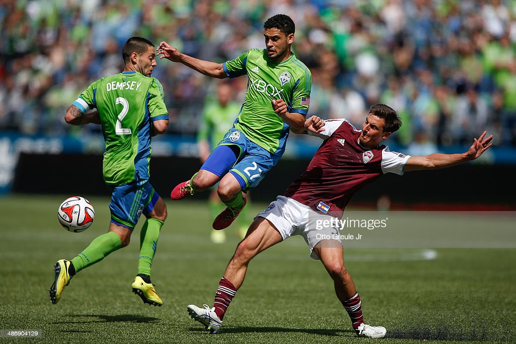 Lamar Neagle #27 of the Seattle Sounders FC battles Thomas Piermayr #5 of the Colorado Rapids at CenturyLink Field on April 26, 2014 in Seattle, Washington. The Sounders defeated the Rapids 4-1.