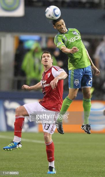 Lamar Neagle of the Seattle Sounders FC heads the ball against Kenny Cooper of the Portland Timbers at Qwest Field on May 14 2011 in Seattle...