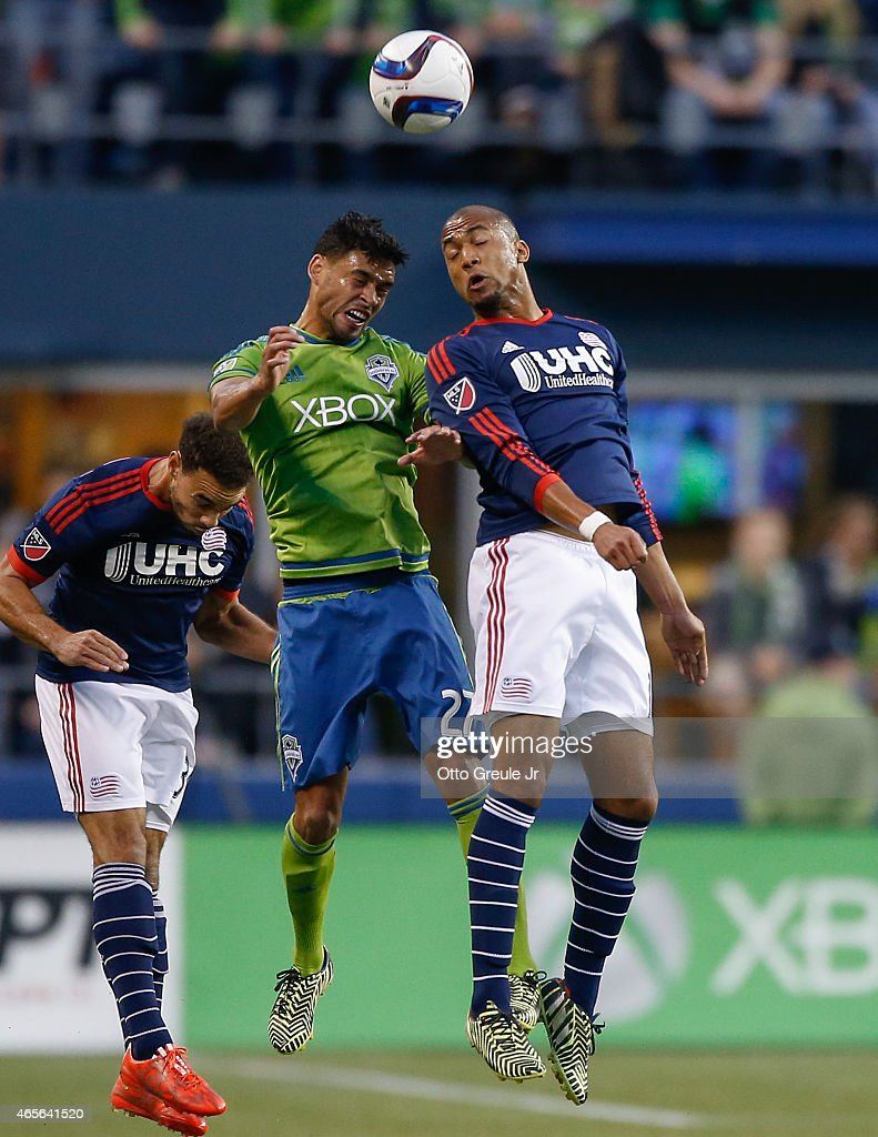 Lamar Neagle #27 of the Seattle Sounders FC heads the ball against Teal Bunbury #10 of the New England Revolution at CenturyLink Field on March 8, 2015 in Seattle, Washington. The Sounders defeated the Revolution 3-0.