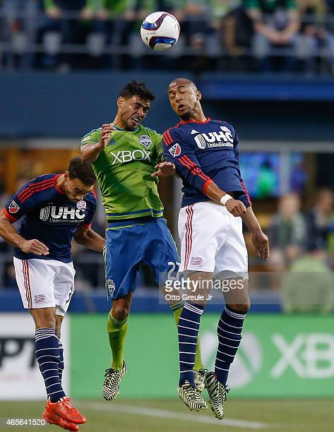 Lamar Neagle of the Seattle Sounders FC heads the ball against Teal Bunbury of the New England Revolution at CenturyLink Field on March 8 2015 in...