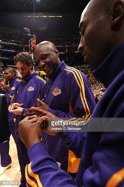 Lamar Odom and Kobe Bryant of the Los Angeles Lakers examine their 2009 NBA Championship rings before taking on the Los Angeles Clippers in the...