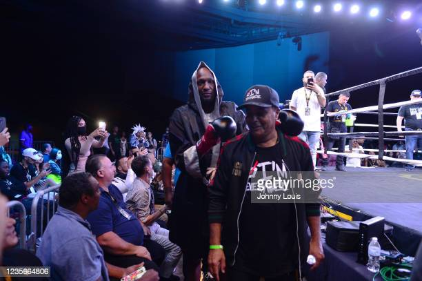 Lamar Odom enters the ring with trainer Milton Lacroix prior to the fight against Ojani Noa during the Heavyweight main event at the Celebrity Boxing...