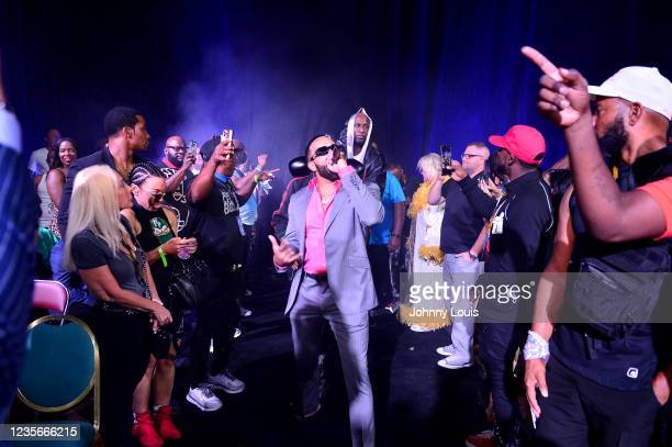 Lamar Odom enters the ring with trainer Milton Lacroix with performance by Ryan Banks prior to the fight against Ojani Noa during the Heavyweight...