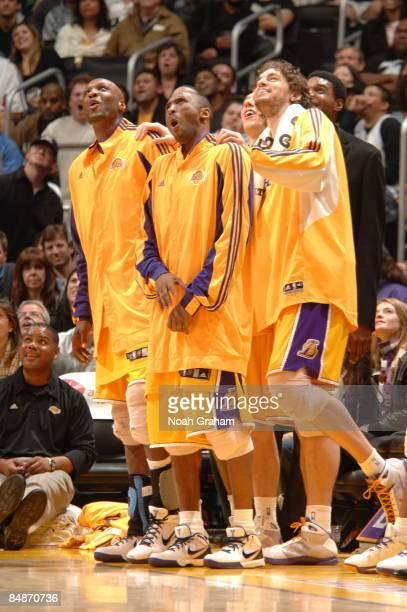 Lamar Odom Kobe Bryant and Pau Gasol of the Los Angeles Lakers react after watching a replay during their game against the Atlanta Hawks at Staples...