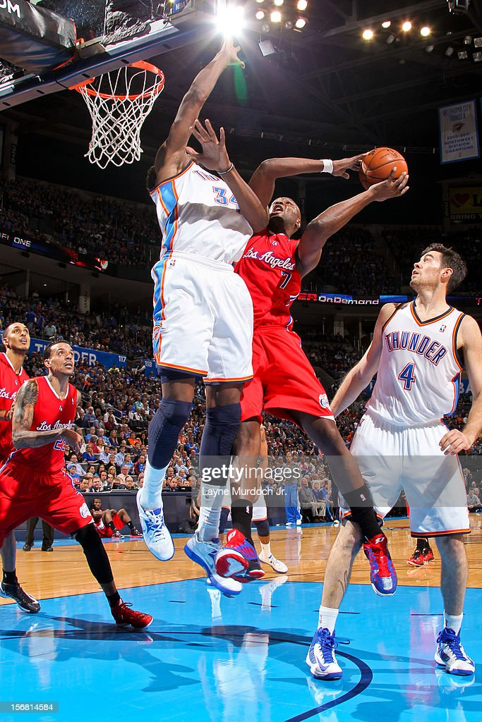 Lamar Odom #7 of the Los Angeles Clippers drives to the basket against Hasheem Thabeet #34 of the Oklahoma City Thunder on November 21, 2012 at the Chesapeake Energy Arena in Oklahoma City, Oklahoma.