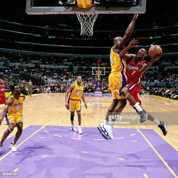 Lamar Odom of the Los Angeles Clippers goes for a layup against Shaquille O'Neal of the Los Angeles Lakers during the NBA game at the Staples Center...