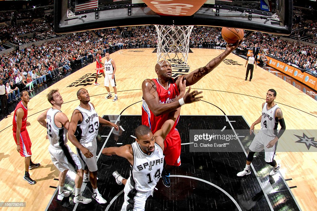 Lamar Odom #7 of the Los Angeles Clippers shoots a layup against Gary Neal #14 of the San Antonio Spurs on November 19, 2012 at the AT&T Center in San Antonio, Texas.
