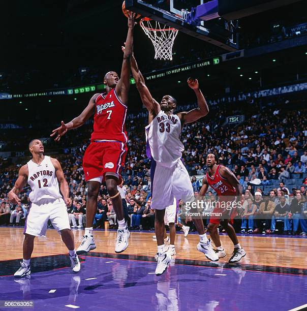 Lamar Odom of the Los Angeles Clippers shoots against Antonio Davis of the Toronto Raptors on October 15 1999 at the Air Canada Centre in Toronto...