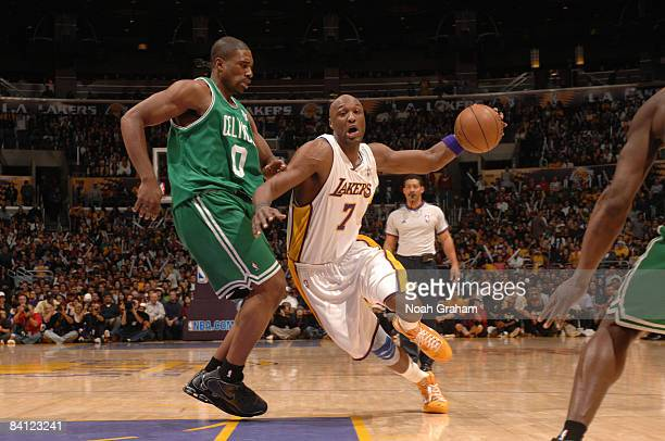 Lamar Odom of the Los Angeles Lakers drives against Leon Powe of the Boston Celtics at Staples Center on December 25 2008 in Los Angeles California...