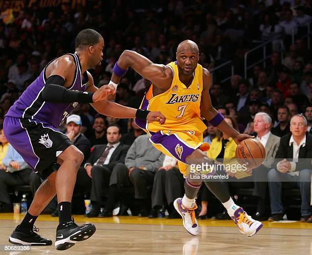 Lamar Odom of the Los Angeles Lakers drives against Sheldon Williams of the Sacramento Kings at Staples Center on April 15 2008 in Los Angeles...