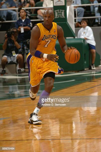 Lamar Odom of the Los Angeles Lakers drives during a preseason game against the Golden State Warriors at Stan Sheriff Center at the University of...