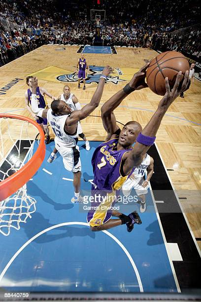 Lamar Odom of the Los Angeles Lakers dunks against Dwight Howard of the Orlando Magic during Game Four of the 2009 NBA Finals at Amway Arena on June...