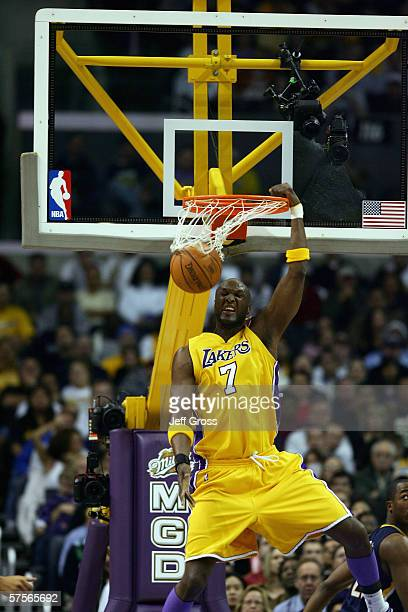 Lamar Odom of the Los Angeles Lakers dunks during the game with the Indiana Pacers at Staples Center on January 9 2006 in Los Angeles California The...