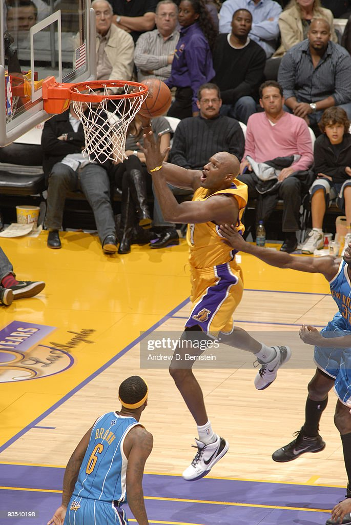 Lamar Odom #7 of the Los Angeles Lakers goes up for a shot against the New Orleans Hornets at Staples Center on December 1, 2009 in Los Angeles, California.