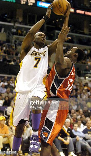 Lamar Odom of the Los Angeles Lakers goes up for a shot during the NBA game between the Los Angeles Lakers and the Charlotte Bobcats at the Staples...