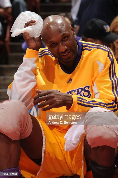 Lamar Odom of the Los Angeles Lakers ices down while sitting on the bench during the game against the Charlotte Bobcats on October 23 2008 at Honda...