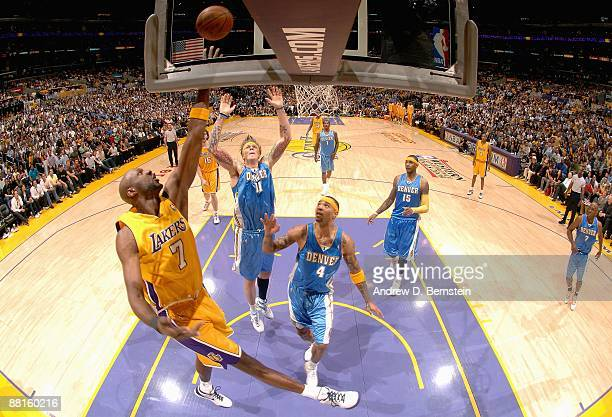 Lamar Odom of the Los Angeles Lakers lays up a shot against Chris Andersen and Kenyon Martin of the Denver Nuggets in Game Five of the Western...