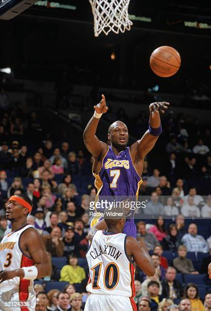 Lamar Odom of the Los Angeles Lakers passes over Speedy Claxton of the Golden State Warriors during a game at the Arena in Oakland on January 15 2005...