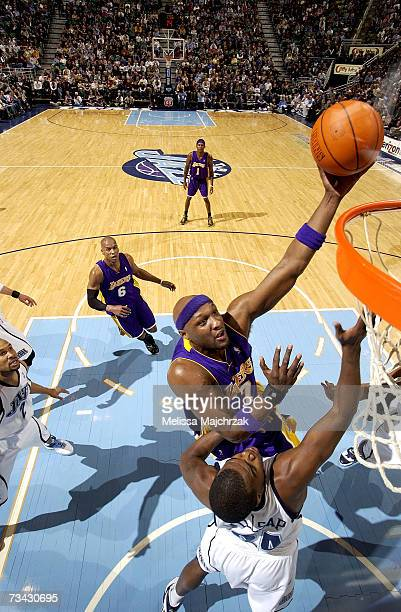 Lamar Odom of the Los Angeles Lakers takes a hook shot over Paul Millsap of the Utah Jazz on February 26, 2007 at the EnergySolutions Arena in Salt...