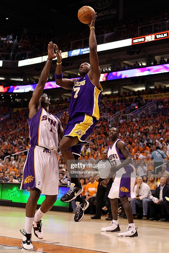 Lamar Odom #7 of the Los Angeles Lakers takes a shot over Amar'e Stoudemire #1 of the Phoenix Suns in the first half of Game Three of the Western Conference Finals during the 2010 NBA Playoffs at US Airways Center on May 23, 2010 in Phoenix, Arizona.