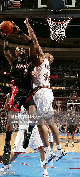 Lamar Odom of the Miami Heat shoots against Derrick Coleman of the Philadelphia 76ers at the Wachovia Center on December 17 2003 in Philadelphia...
