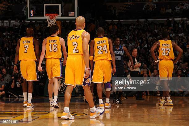 Lamar Odom Pau Gasol Derek Fisher Kobe Bryant and Ron Artest of the Los Angeles Lakers stand on the court during a game against the Utah Jazz at...