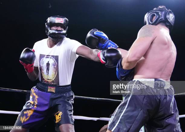Lamar Odom punches Ojani Noa during the second round of the Celebrity Boxing Miami 2021 Lamar Odom vs Ojani Noa at the James L. Knight Center on...